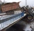 ВВологодском районе трактор опрокинулся смоста
