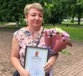 Череповчанке дали грамоту заспасение пенсионерки отмошенников